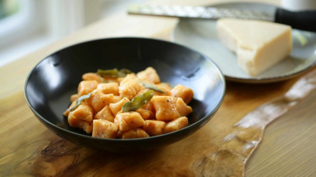 Sweet Potato Gnocchi Recipe with Brown Butter and Sage Sauce in black bowl