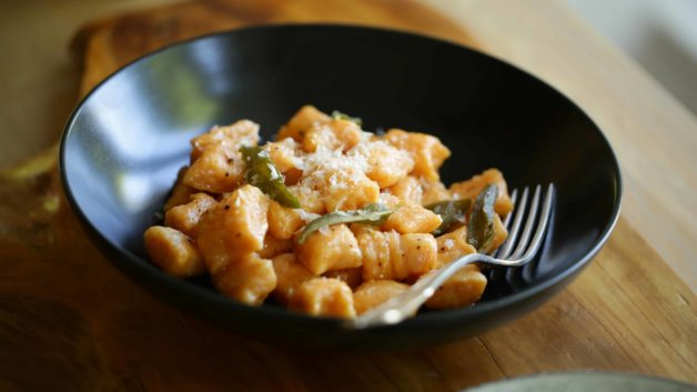 Sweet Potato Gnocchi with Brown Butter and Sage sauce in a bowl with fork