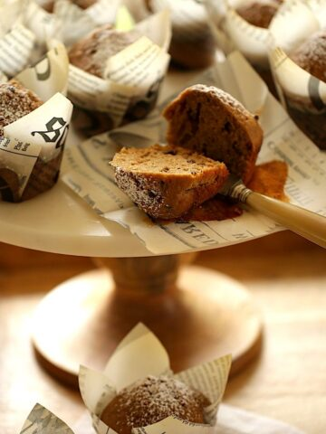 Cappuccino Muffins sliced and placed on a marble cake stand
