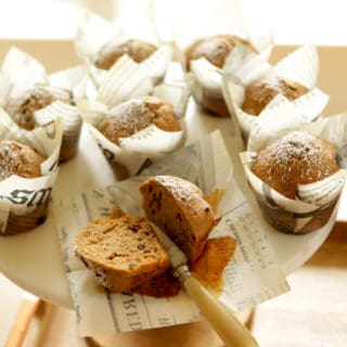 Cappuccino Muffins on a cake stand in newspaper themed muffin papers