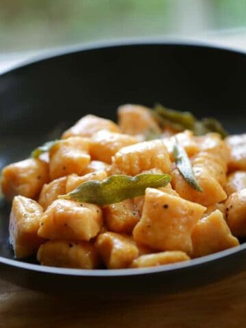 Sweet Potato Gnocchi with Brown Butter and Sage in a black bowl