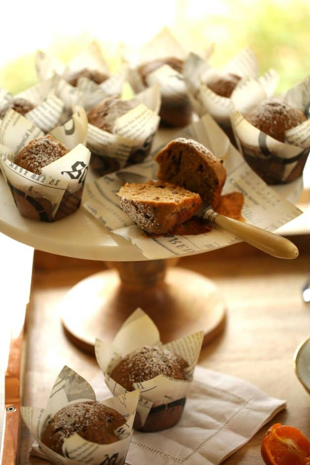 Cappuccino Muffin Recipe on cake stand with one muffin sliced open