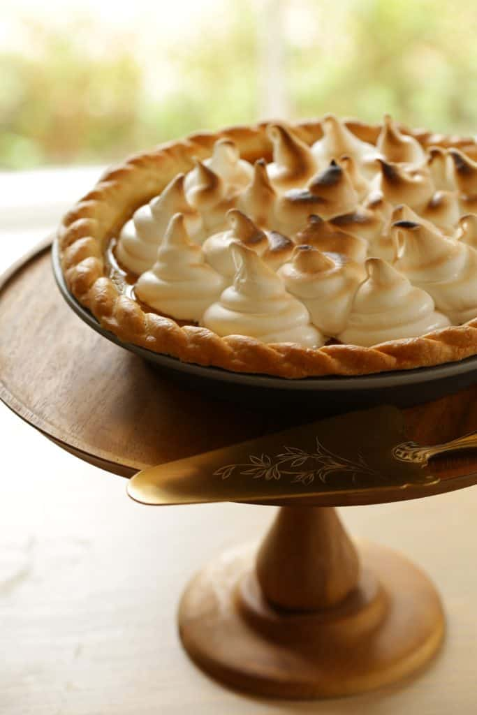Pumpkin Pie with Marshmallow Topping on a cake stand