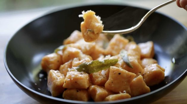 Sweet Potato Gnocchi with Brown Butter and Sage sauce with fork taking a bite