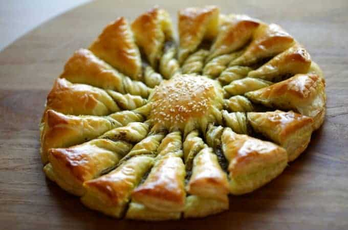 Tarte au Soleil with pesto on cutting board