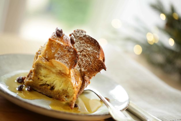 A slice of Gingerbread French Toast with Cinnamon Syrup on a plate