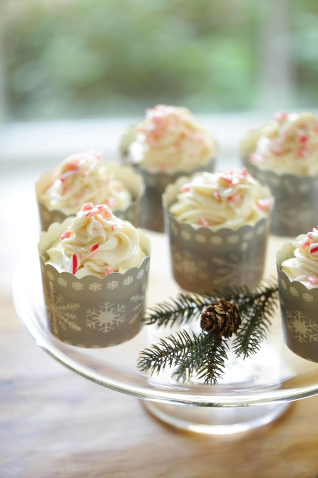 Chocolate Candy Cane Cupcakes in snowflake cupcake liners on a cake stand