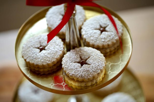 Chocolate Hazelnut Linzer Cookie Recipe on a cake stand