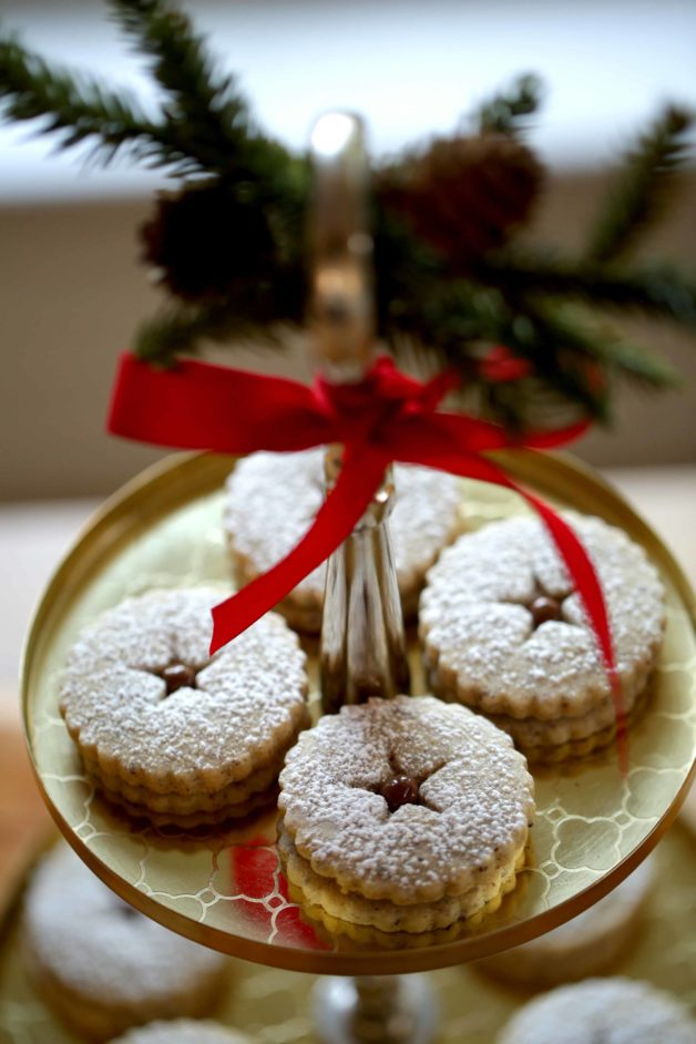 Chocolate Hazelnut Linzer Cookie Recipe on gold tiered tray