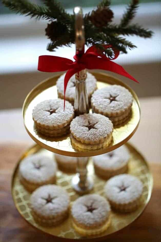 Chocolate Hazelnut Linzer Cookie Recipe on two-tiered gold cookie stand