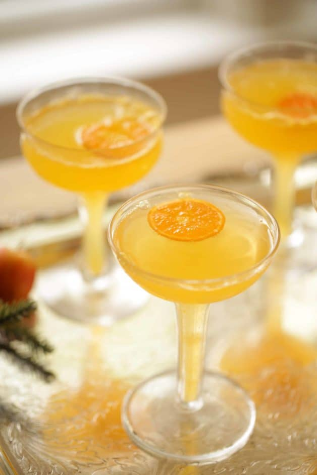 Clementine Mimosa For New Years Eve served in a champagne coupe
