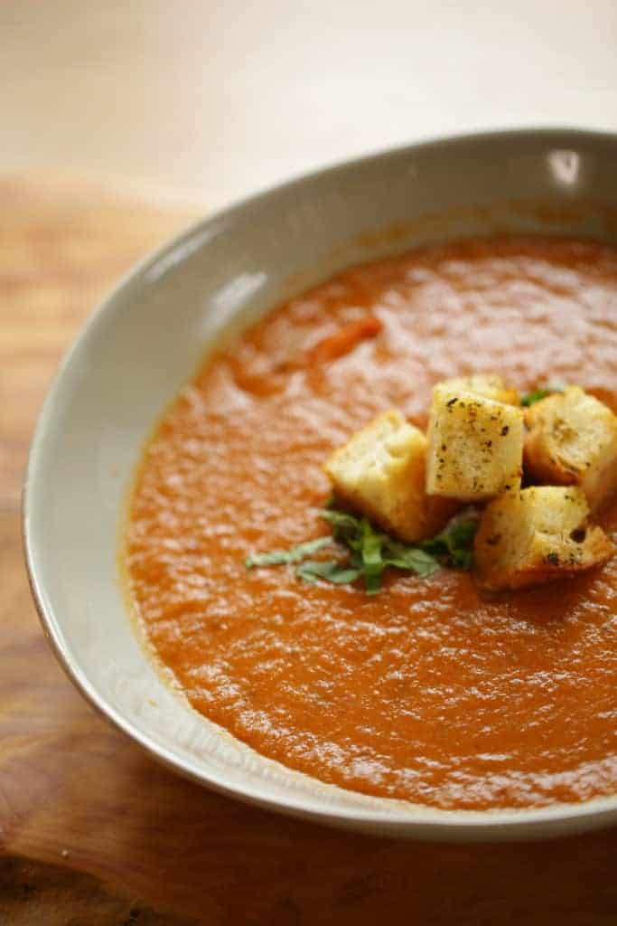 Close up shot of Tomato soup in bowl with Croutons