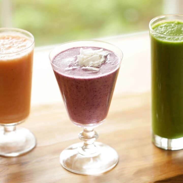 3 Smoothies in a Glass sitting on a Table