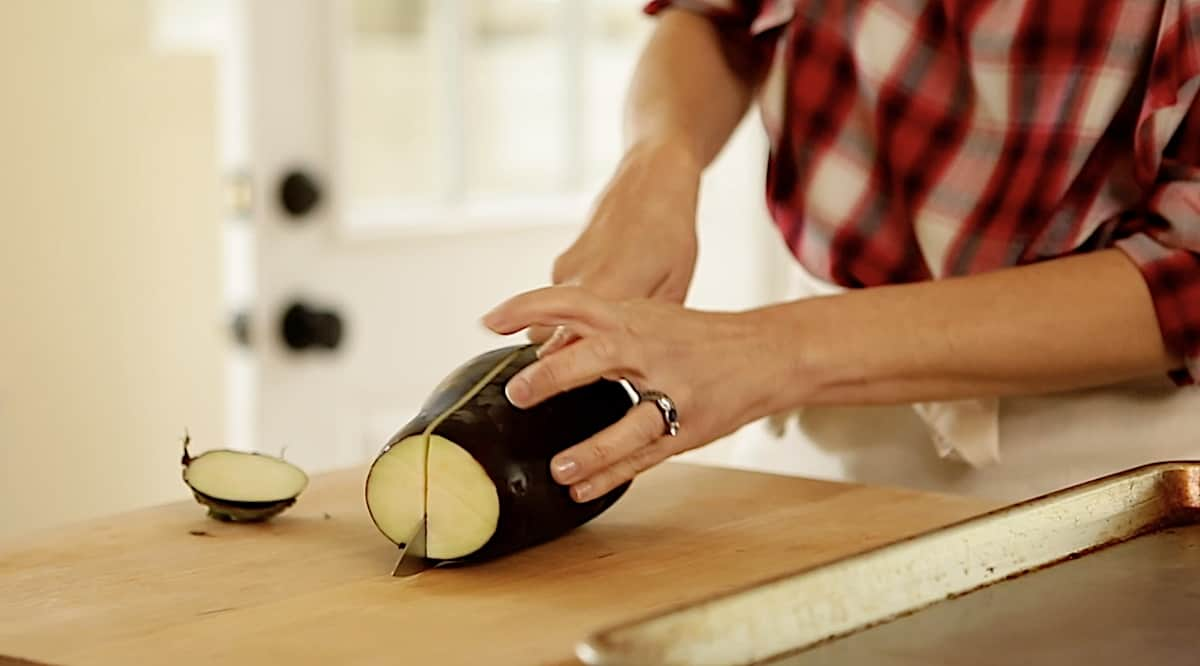 slicing eggplant in half