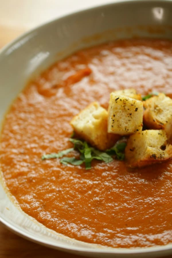 Tomato and Eggplant Soup in a bowl with croutons