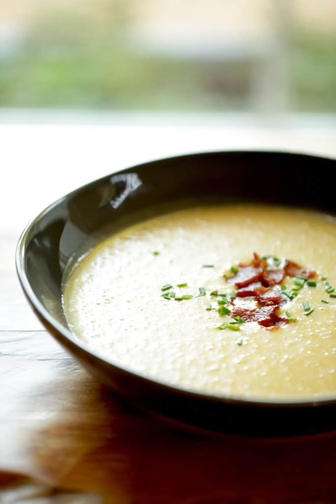 Potato Cheddar Bacon Soup in a black bowl