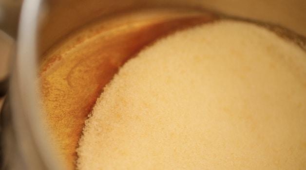 sugar melting in a pot becoming amber