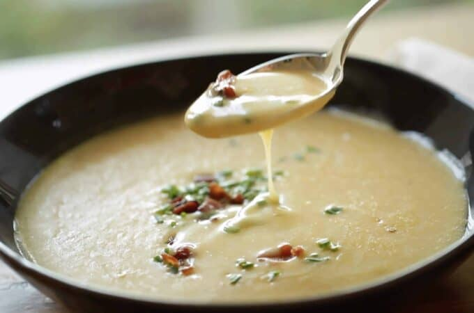 A spoon tasting a Potato Cheddar Bacon Soup Recipe