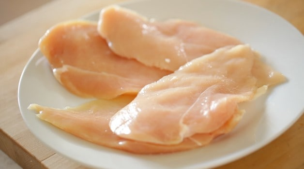 raw chicken breasts on a plate