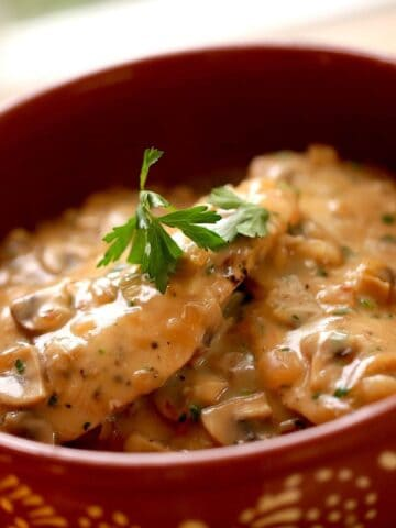 White Wine Chicken Recipe in a terra cotta bowl