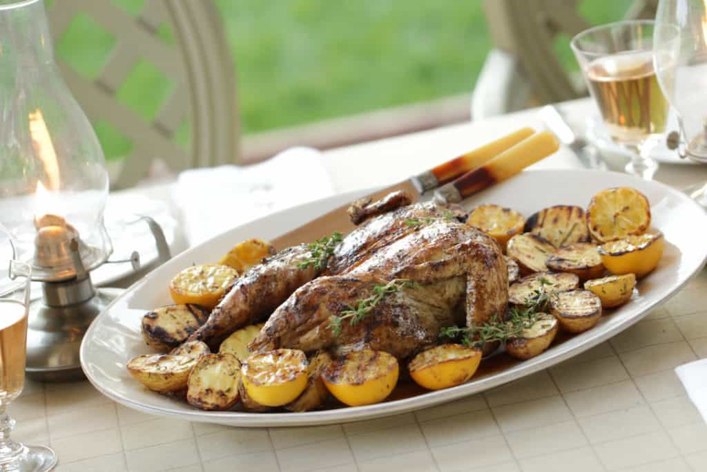 Grilled Whole Chicken on plate with Grilled Potatoes