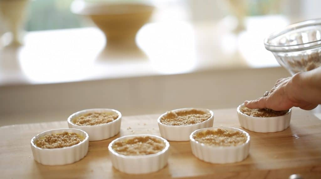Creme Brulees ready for the oven topped with brown sugar