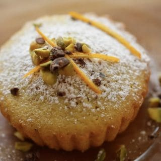 Pistachio Olive Oil Cake on Plate served with garnishes