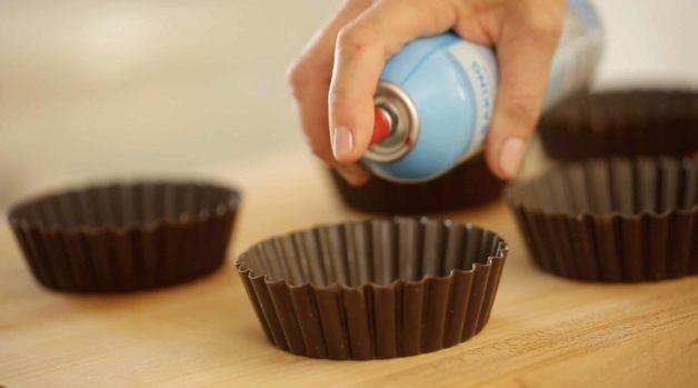 Preparring Mini Tart Tins for Pistachio Olive Oil Cakes