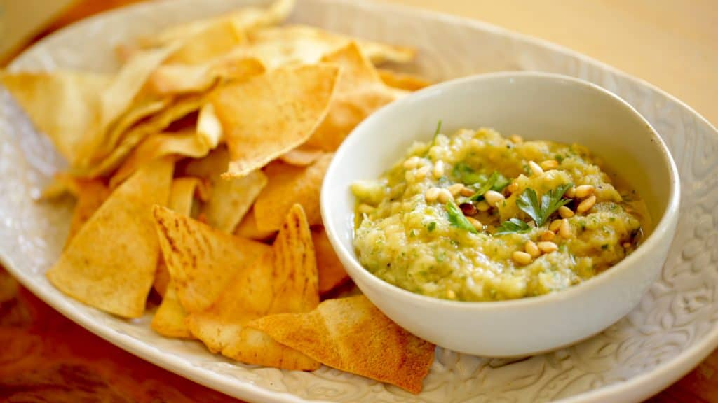 Bowl of Baba Ganoush with homemade pita chips