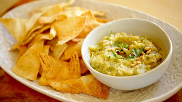 Bowl of Baba Ganoush with homemade pita chips