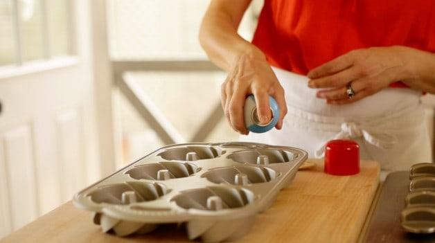 Spraying mini bundt cake tins