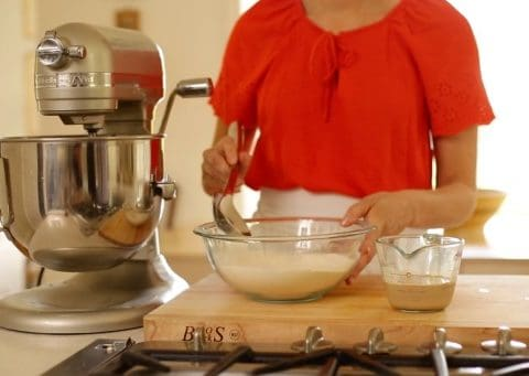 a person mixing dry ingredients for a pound cake