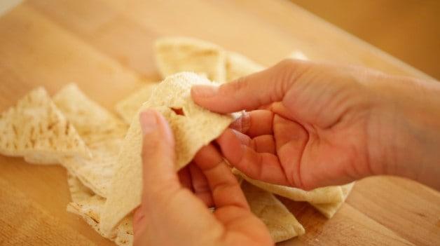 Splitting open a pita triangle