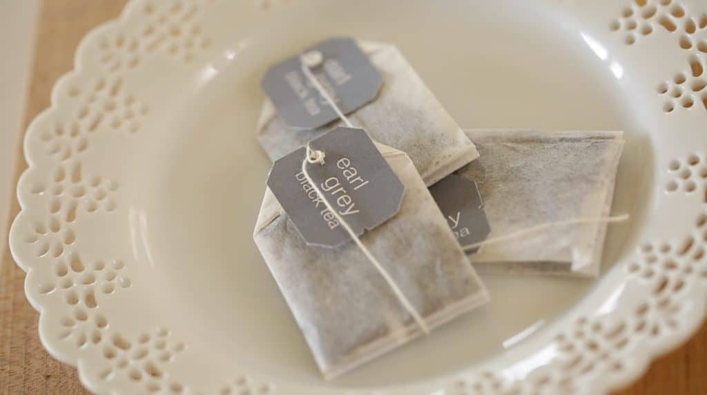 Earl Grey Tea Bags on Pierced white plate for Earl Grey Pound Cake Recipe