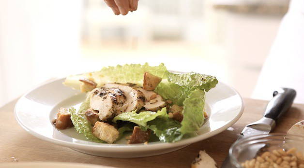 Adding Pinenuts to a chicken caesar salad