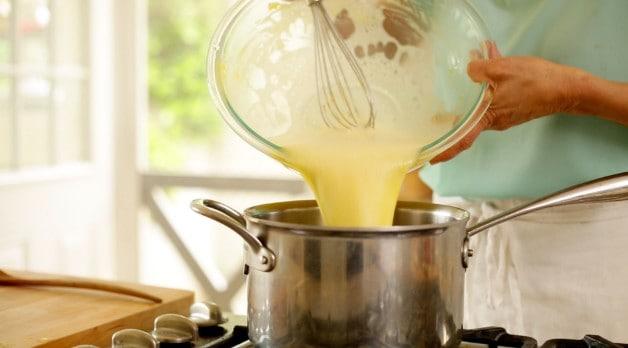 Yellow tart mixture poured into sauce pan