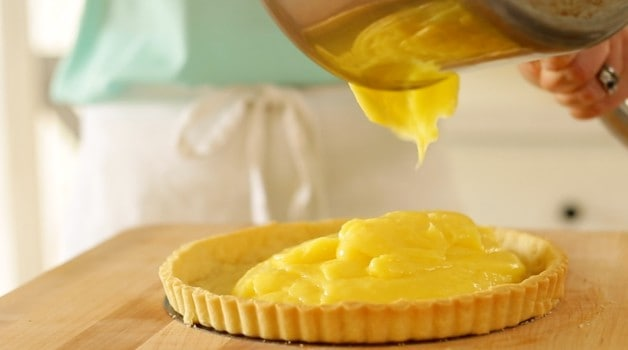 lemon tart mixture poured into tart crust