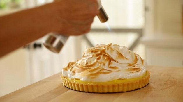 Kitchen torch browning meringue for lemon meringue tart