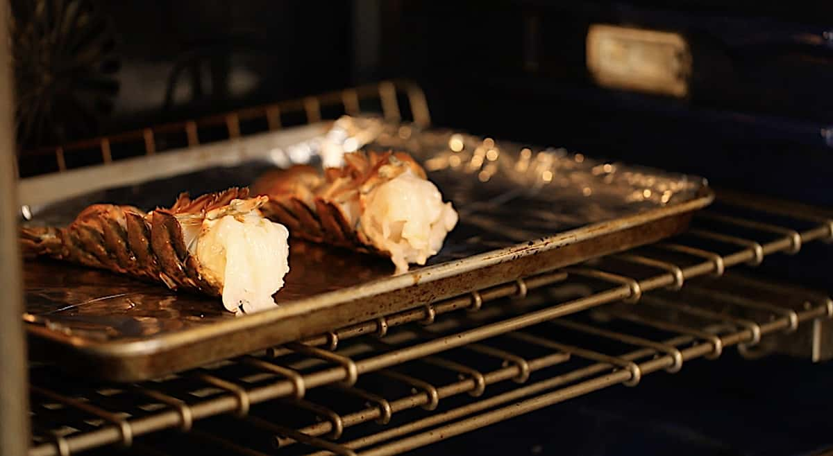 Lobster Tails baking in the oven on a sheet pan