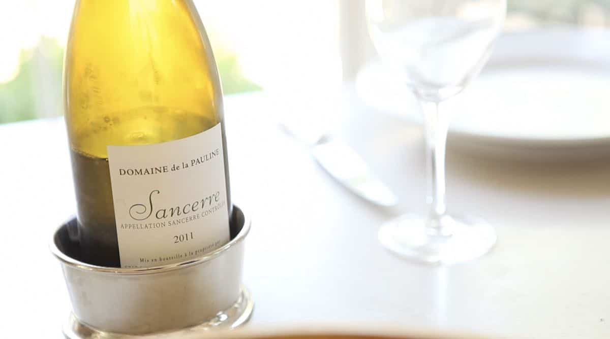 a bottle of sancerre wine on a table