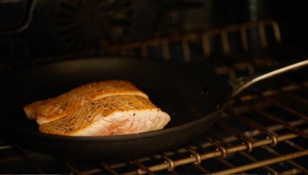 Salmon seared in pan in oven