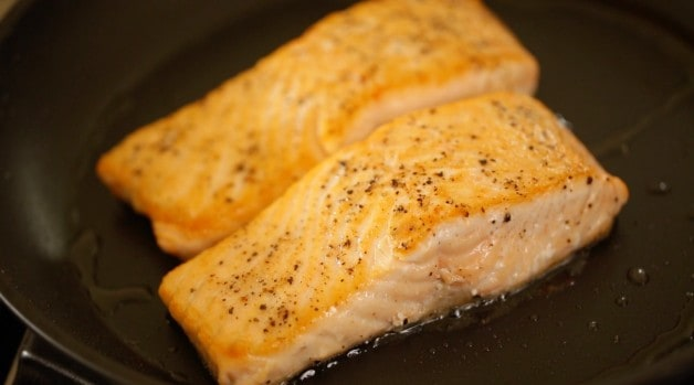 Two Salmon filets seared in pan
