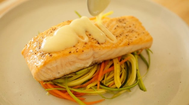 Pan Seared Salmon with Beurre Blanc on plate with veggie nests
