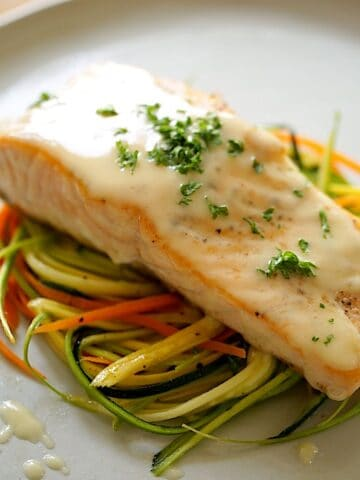 Seared Salmon with Buerre Blanc Sauce on a bed of veggies