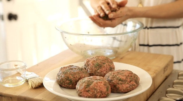 forming burger patties and placing them on a plate