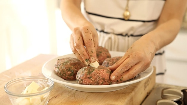 inserting butter into a patty