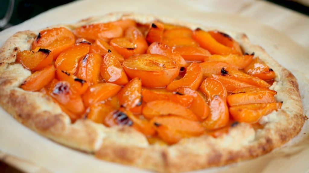 apricot galette baked and served on parchment paper