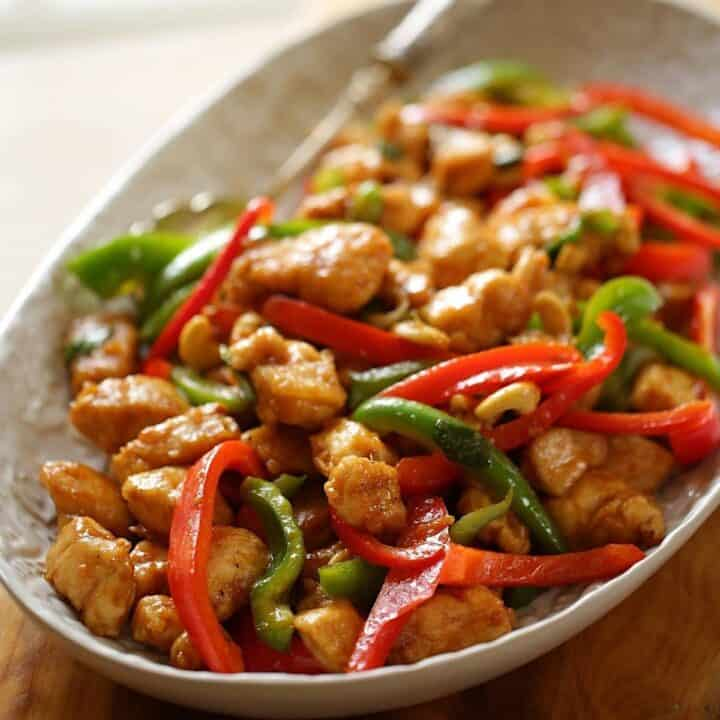 A platter of cashew chicken with peppers