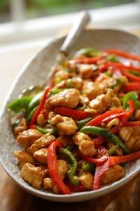 Easy Cashew Chicken Recipe in an oval platter vertical orientation