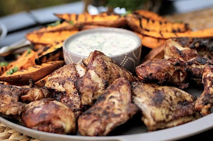 a platter of grilled cinnamon chicken and sweet potatoes